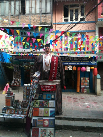 This delightful statue, and the flags behind him, are what remains of the festival of Tihar which ended yesterday.