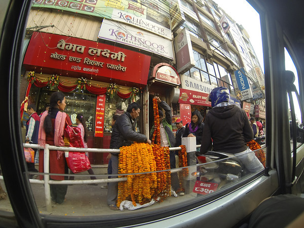 Tihar is one of the big festivals of Nepal; the city becomes garlanded with the flower garlands you see on sale here.