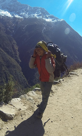 He's amazingly strong - he's carrying about 20 kilos up these hills - and always smiling.