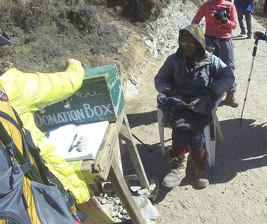 This elderly gentleman has been collecting money on the path between Namche and Pangboche and points west daily for a decade.
